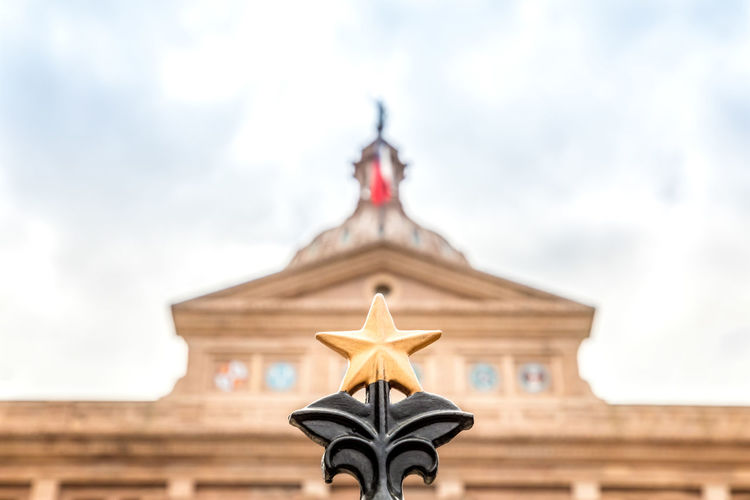 Texas star in front of the Texas Capitol, Austin Texas Capitol Star Fence Pride Austin State Building Capital Sky Day Downtown Dome Government Travel Blue Architecture City USA Landmark Monument Congress Old Historic Flag Federal Tourism Stone Cloud Statue America Law Politics United Legislature  TX Political Symbol Spring Space Green Outdoors Travel Destinations Building Exterior History