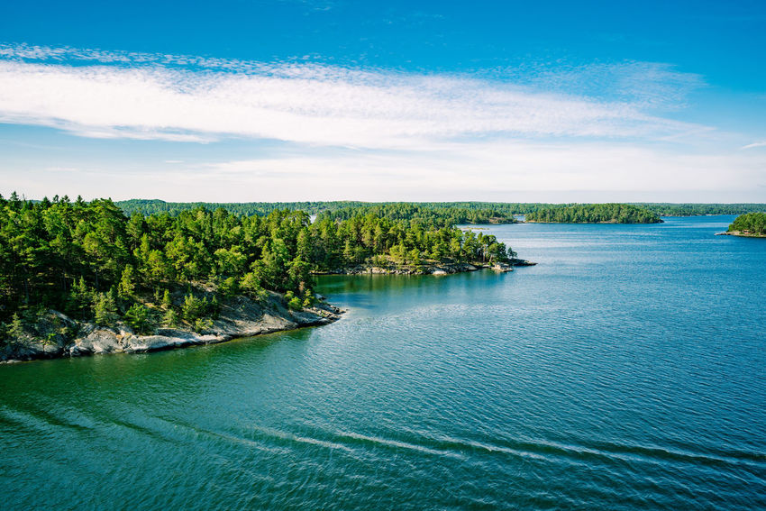 Scenery of tree overgrown skerries and water close to Stockholm Archipelago Baltic Sea Freshness Nature Skärgård Swedish Swedish Nature Beauty In Nature Blue Clean Day Green Color Landscape Nature No People Outdoors Scenics Sea Skerry Skerry Landscape Sky Tranquil Scene Tranquility Tree Water