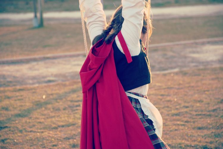 Little Red Riding Hood Casual Clothing Childhood Day Field Focus On Foreground Holding Human Hand Leisure Activity Lifestyles Midsection Nature One Person Outdoors People Real People Standing Women