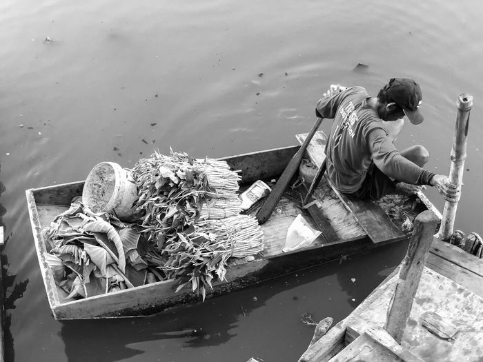 High angle view of men in boat on sea