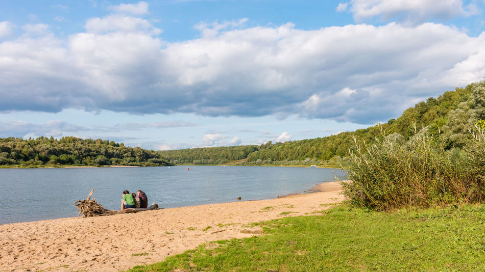 Rest on the Oka river, Russia, Polenovo Russia Russia. Polenovo Tula Oblast Beach Beauty In Nature Cloud - Sky Clouds Day Grass Nature Oka Outdoors Polenovo Real People River Sand Scenics Sky Strakhovo Tranquil Scene Tranquility Tree Water