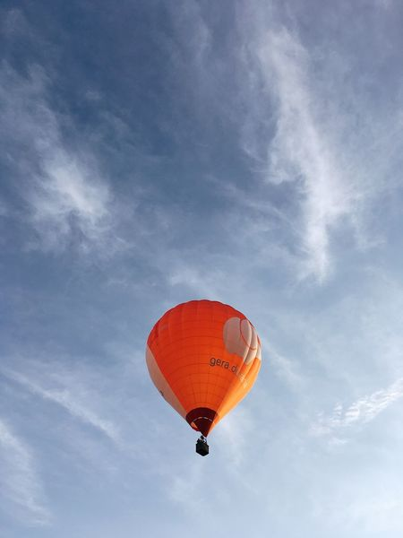 Warm Light Sky Air Vehicle Balloon Low Angle View Cloud - Sky Flying Transportation Hot Air Balloon Adventure Nature Parachute Moving Up Blue Day Red Sport Celebration Freedom Mid-air Extreme Sports