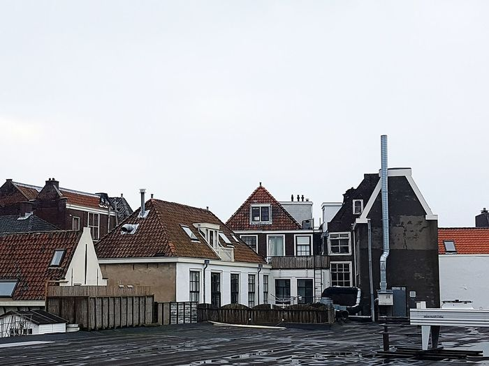 Rooftops In leiden Building Exterior Built Structure Architecture Residential Structure House Town Day Sky Outdoors Façade No People Surface Level Residential District Rooftop Leiden Nethetlands Rooftop Roof Rooftops Roofs City Life Scenics City Clouds Cloud - Sky
