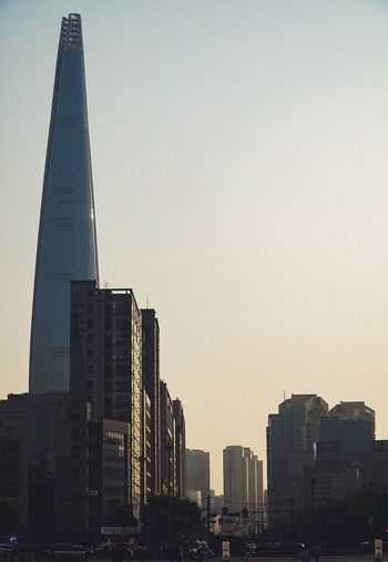 Architecture Skyscraper Built Structure Building Exterior Tall - High Tower City Modern Travel Destinations Cityscape Sunset Clear Sky Urban Skyline No People Downtown District Tall Outdoors Sky Day Lotteworld Tower