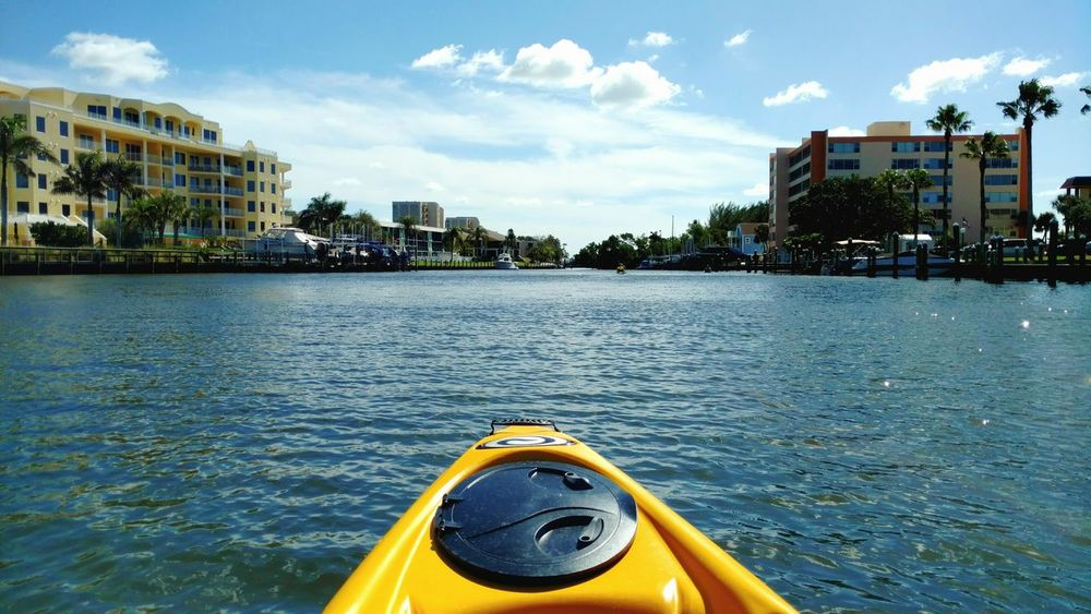 Kayaking Water Outdoors Canals And Waterways Leisure Activity Me Time Recreational Ride Recreational  Recreational Activity Peaceful Surroundings Downstream Nautical Vessel Watersports Water Brackish Water Sarasota Florida Waterfont Homes Rowing Through Day Sky I Love Kayaking Clouds Nature Peaceful