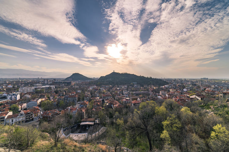 Summer sunset over Plovdiv city, Bulgaria. European capital of culture 2019 and the oldest living city in Europe. Photo from one of the hills in the city. Building Exterior Architecture Built Structure Sky Cloud - Sky City Building Residential District Cityscape Nature Tree Crowded Plant High Angle View Sunset Environment House Town Outdoors TOWNSCAPE Plovdiv Panorama Bulgaria