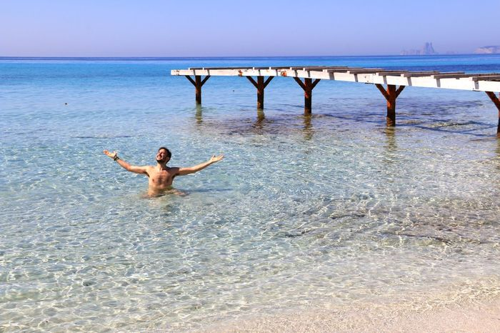 Finally summer EyeEmNewHere Swimming Ses Salines Ses Illetes Formentera Summer Water Sea Real People Lifestyles Sky Men Summer Exploratorium Leisure Activity Beach Shirtless Human Arm Limb One Person Adventures In The City #FREIHEITBERLIN