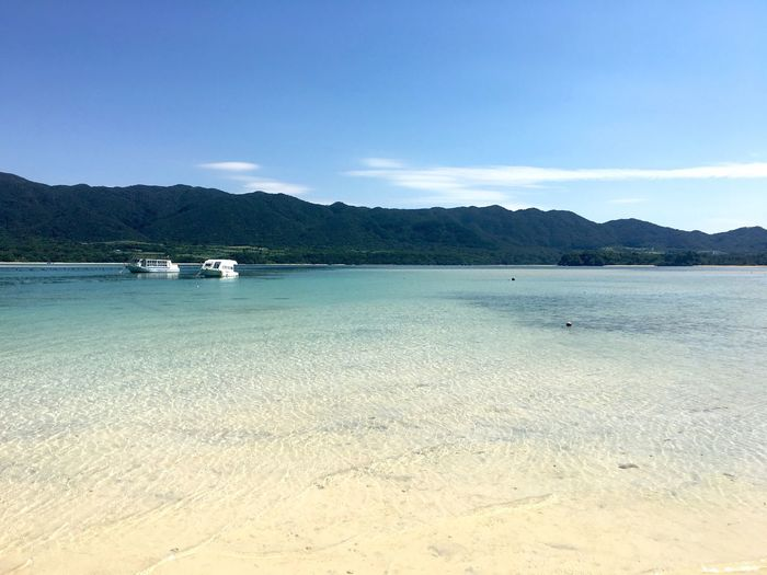 Mountain Water Beach Tranquility Tranquil Scene Scenics Blue Sea Calm Beauty In Nature Waterfront Nature Shore Non-urban Scene Sky Mountain Range Majestic Seascape Vacations No People Crystal Clear Clean Okinawa