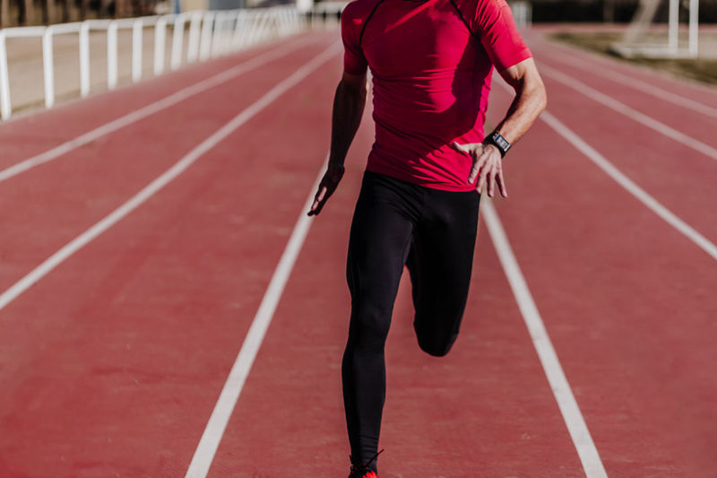Athlete running on sports track