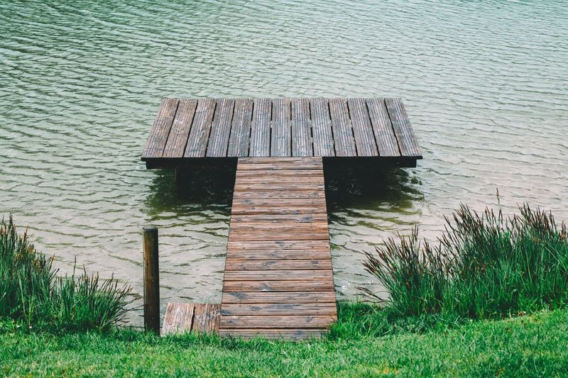 Wooden posts on lake