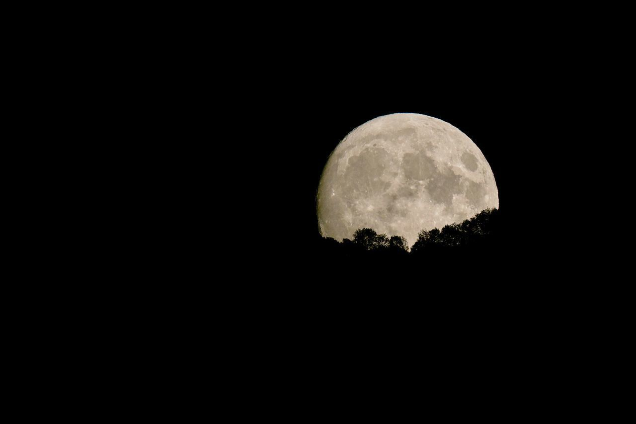 moon, space, night, sky, astronomy, planetary moon, copy space, beauty in nature, scenics - nature, circle, no people, low angle view, moon surface, tranquility, nature, geometric shape, tranquil scene, idyllic, full moon, shape, outdoors, dark, moonlight, space and astronomy