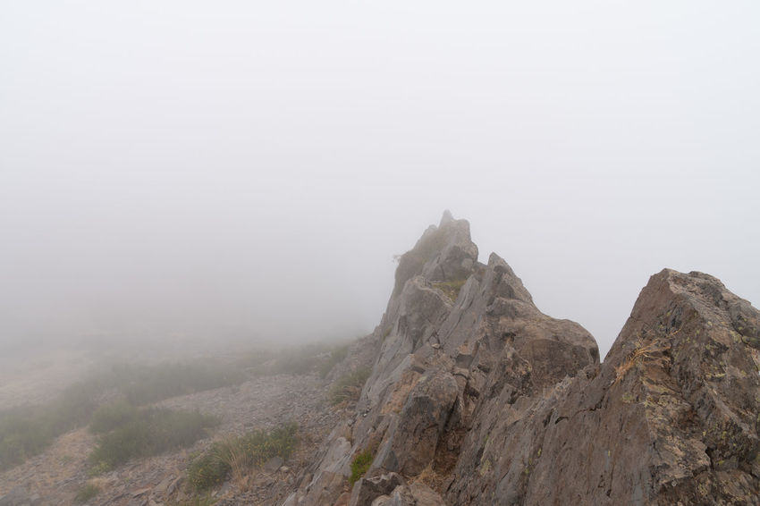 Fog Tranquil Scene Mountain Tranquility Beauty In Nature Nature Scenics - Nature No People Sky Copy Space Landscape Environment Rock Idyllic Day Non-urban Scene Outdoors Land Exploration Mountain Peak Formation High