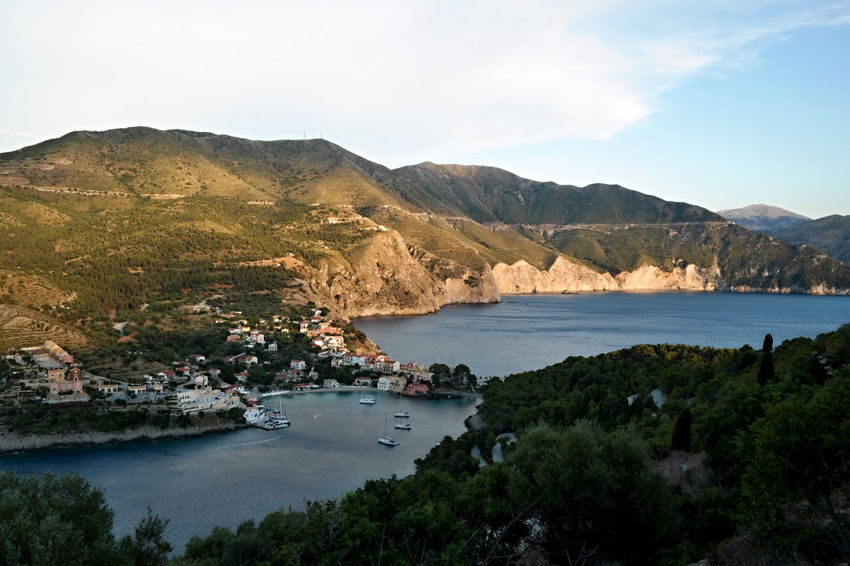 Assos, Kefalonia, Greece Mediterranean Sea Trees Architecture Beauty In Nature Built Structure Evening Shadow Landscape Mountain Mountain Range Nature Nautical Vessel No People Outdoors Peninsula Scenics Sky Spectacular View Town Tranquility Village Water The Week On EyeEm Lost In The Landscape