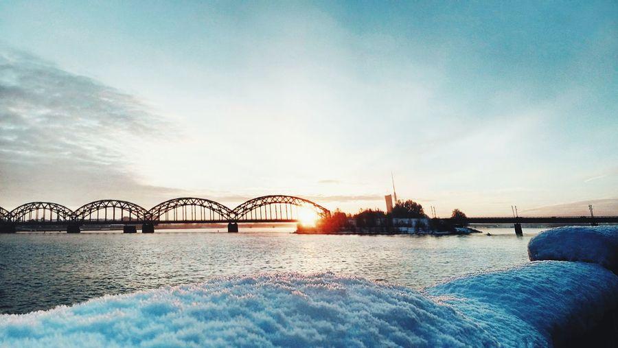 Distance shot of bridge at calm sea