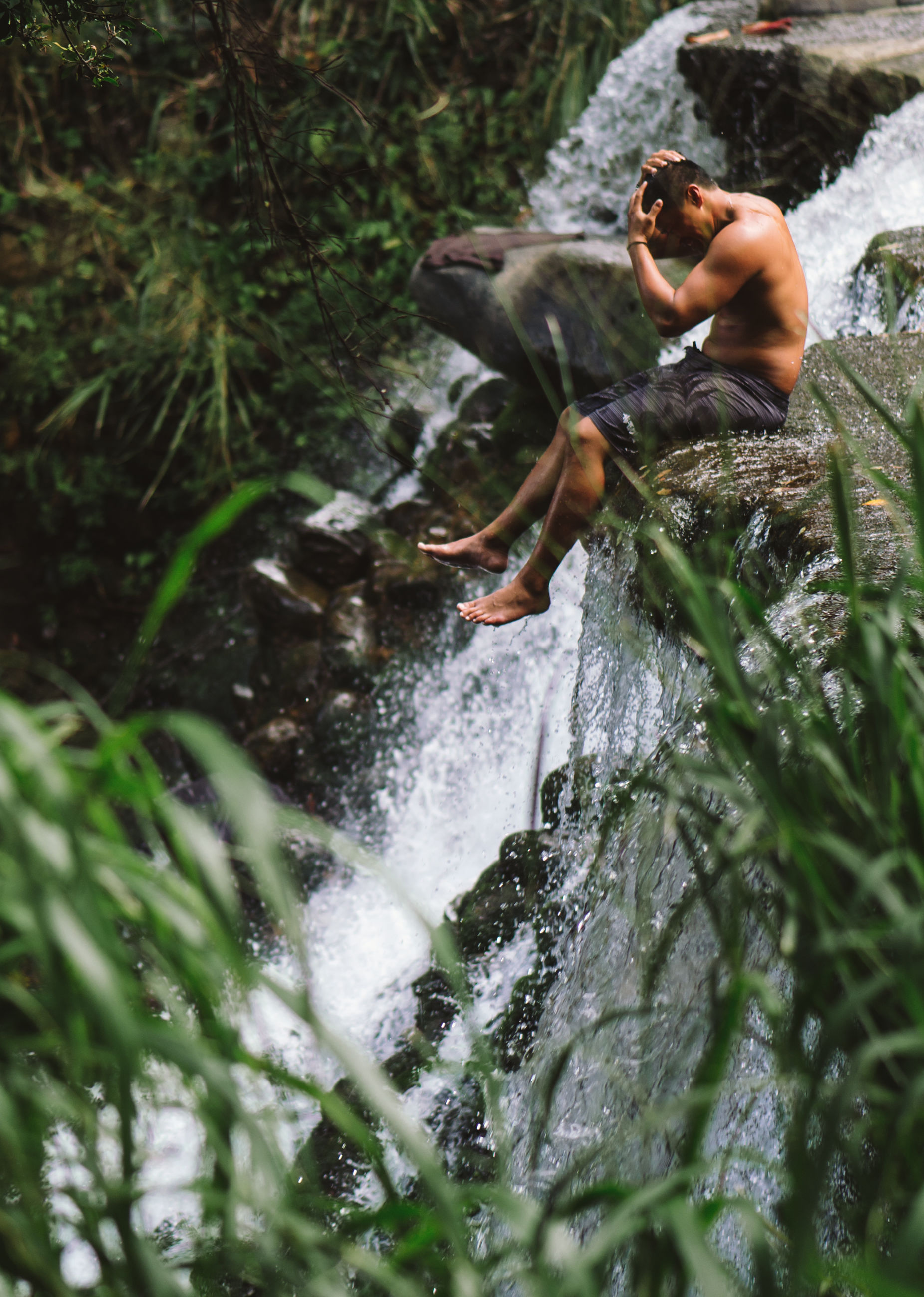 water, rock - object, real people, motion, nature, outdoors, day, leisure activity, waterfall, one person, lifestyles, men, full length, beauty in nature, tree, mammal, young adult, people