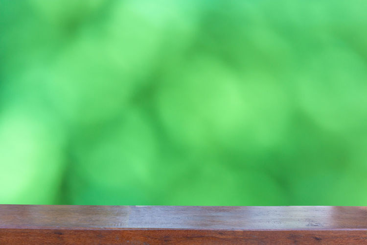 Empty wood table top on Abstract Blurred green bokeh background Green Color No People Wood - Material Table Indoors  Copy Space Close-up Absence Empty Selective Focus Nature Single Object Textile Still Life Day Textured  Focus On Foreground Material Sport Clean