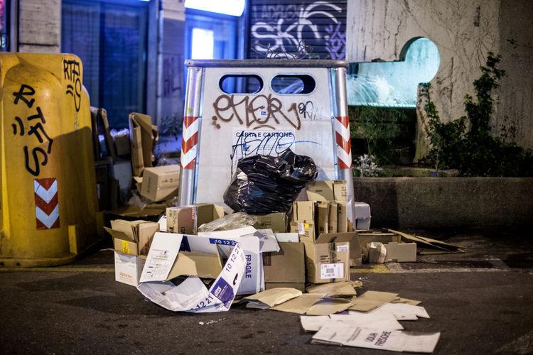 Garbage by bin at night