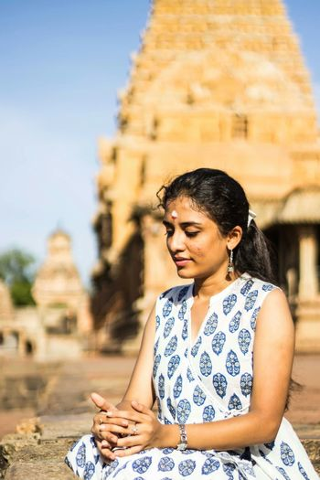 Portrait Young Girl One Person Sitting Meditatingprayer Religion Young Adult Day Travel Beautiful People History Outdoors Brahadeewarar Tanjore_big_temple The Portraitist - 2017 EyeEm Awards