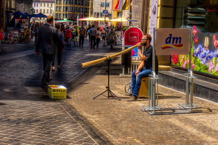 Alphorn-Bläser in der Leipziger str. Alphorn Architecture Building Exterior Built Structure City Day Men Musiker Outdoors People Real People Sitting Straßenmusiker Streetphotography