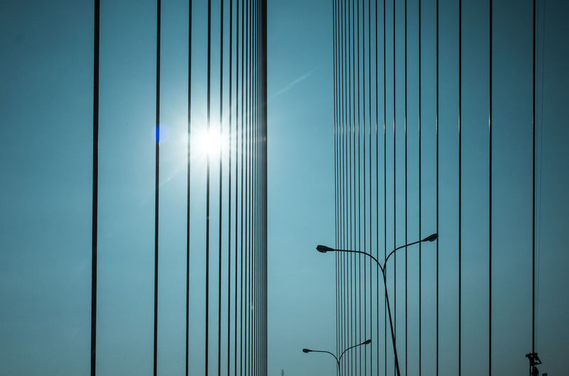 Sunlight Blue Metal No People Sunbeam Day Nature Sky Sun Built Structure Architecture Street Light Outdoors Pattern Lighting Equipment Wall - Building Feature Low Angle View Sunny Cable Lens Flare Electricity