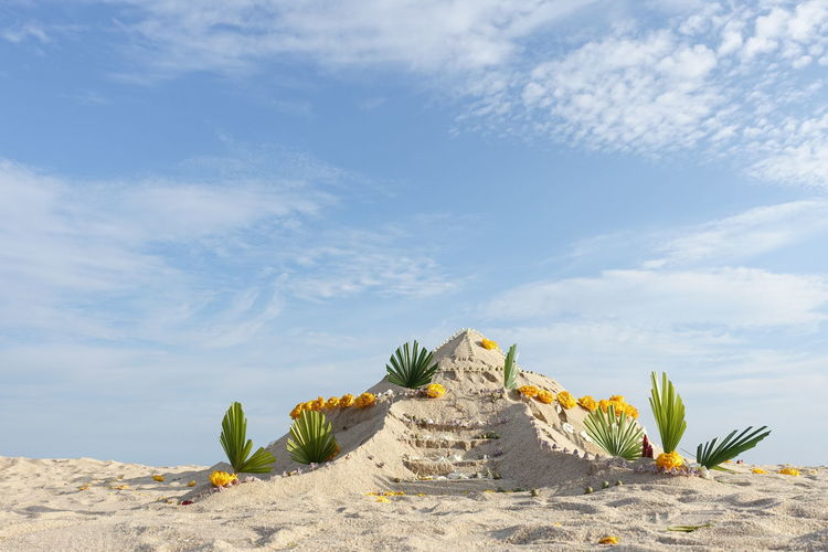 Low angle view of sand castle against sky