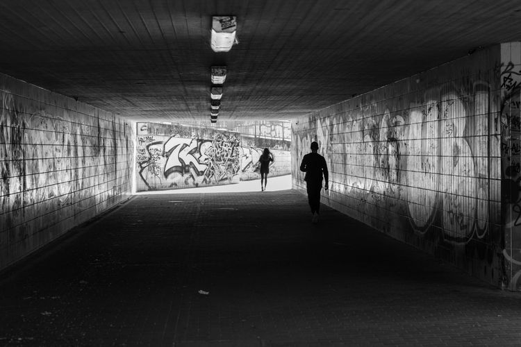 Brandenburg Brieselang Graffiti Architecture Built Structure Full Length Illuminated Indoors  Lifestyles Light At The End Of The Tunnel Men One Person People Public Transportation Real People Silhouette Subway The Way Forward Tunnel Underground Walkway Walking Wall - Building Feature