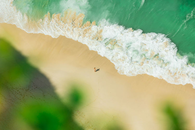 Aerial view of woman standing at seashore