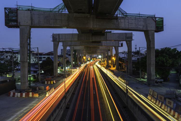 Light trails on railroad track at night
