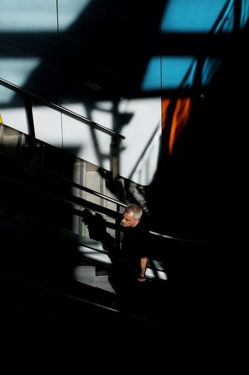 High angle view of man walking on staircase