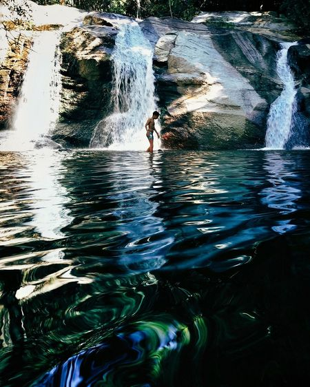 Child bathes in waterfalls Adventure Beauty In Nature Day Nature One Person Swimming Water Waterfall
