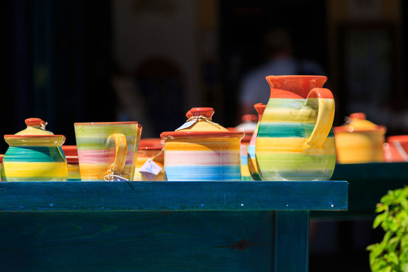 Close-Up Of Multi Colored Crockery On Table
