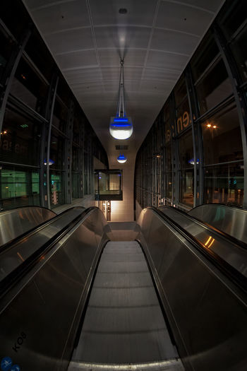 Escalator At The Airport Downwards Finland Helsinki Scandinavia Airport Architecture Built Structure Ceiling Down Escalator Illuminated Indoors  Lighting Equipment Modern Night No People The Way Forward