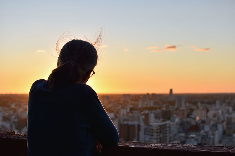 Rear view of woman looking at sunset in buenos aires