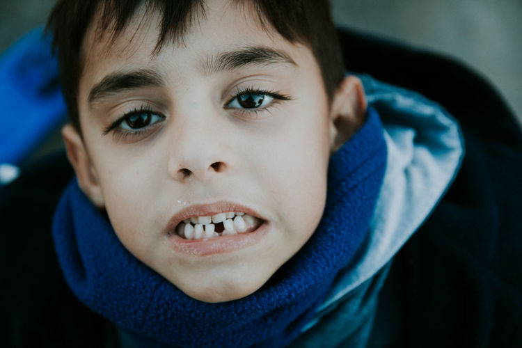 High angle portrait of cute boy showing gap toothed