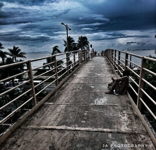 Cloud - Sky Sea Railing Sky Horizon Over Water Water Outdoors Beach Day Nature No People Built Structure Tree Storm Cloud Beauty In Nature Beggar Beggarman Beggar In The City Beggars Cant Be Choosers Poverty