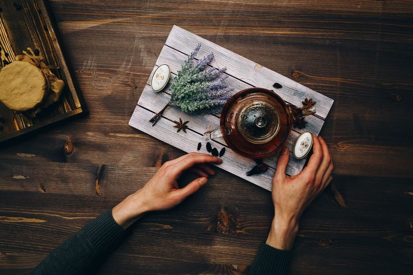 Table High Angle View One Person Human Body Part Human Hand Hand Holding Adult Real People Indoors  Directly Above Photography Themes Wood - Material Lifestyles Food And Drink Technology Leisure Activity Personal Perspective Women Nail