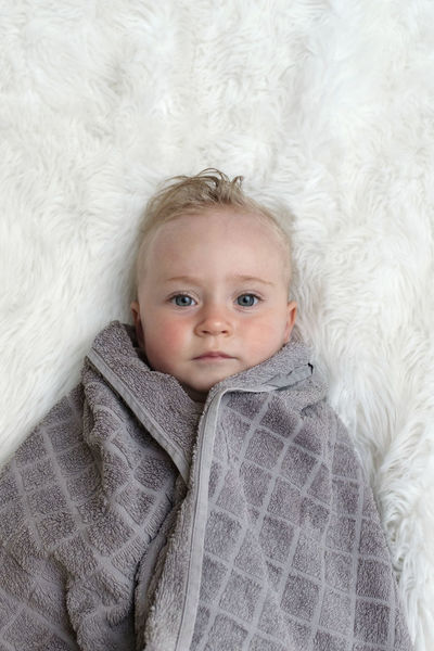 Bed Blond Hair Child Childhood Cute Front View Fur Headshot Indoors  Innocence Lifestyles Looking At Camera Lying Down One Person Portrait Real People Relaxation Softness Warm Clothing The Portraitist - 2018 EyeEm Awards