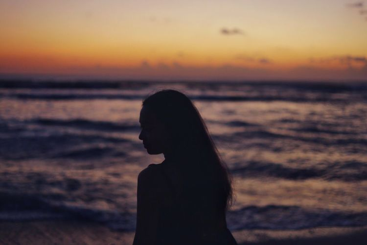 The Fallen. Sunset Sea Silhouette Beach Horizon Over Water Vacations Side View Nature Tranquility Explore Youth Girl woman Isolation emotion Feelings Ocean