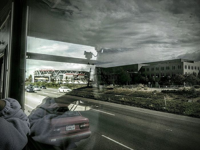 Reflections Building Photography Architecture Photography Eye4photography  Reflections In The Glass Windows View From The Bus Window My Photography Taking Photos ❤ Feel The Journey Freeway Scenery Road Trip ♥ Clouds And Sky Highway 880 Cars And Traffic Highway Photography San Francisco Bay Area Freeway Landscape Oracle Stadium Oakland Ca Oakland California Oakland Coliseum