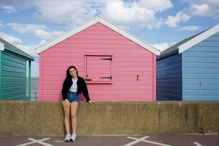 Pink beach hut with model