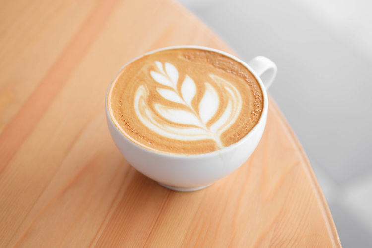 Refreshment Coffee Drink Food And Drink Coffee - Drink Mug Frothy Drink Coffee Cup Latte Cup Hot Drink Cappuccino Froth Art Still Life Cafe Table Wood - Material Close-up High Angle View Saucer No People Crockery Caffeine Breakfast