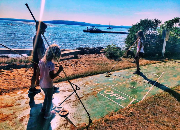 Shuffleboard Cousins  Greatlakes Lakesuperior Wisconsin Madelineisland Water Sea Sky Real People Nature One Person Sunlight Beach Outdoors Leisure Activity