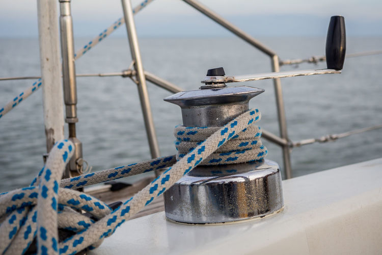Lithuania Cleat Close-up Day Focus On Foreground Metal Mode Of Transportation Nature Nautical Equipment Nautical Vessel Neringa No People Outdoors Post Railing Rope Sea Security Steel Strength Tied Up Transportation Water