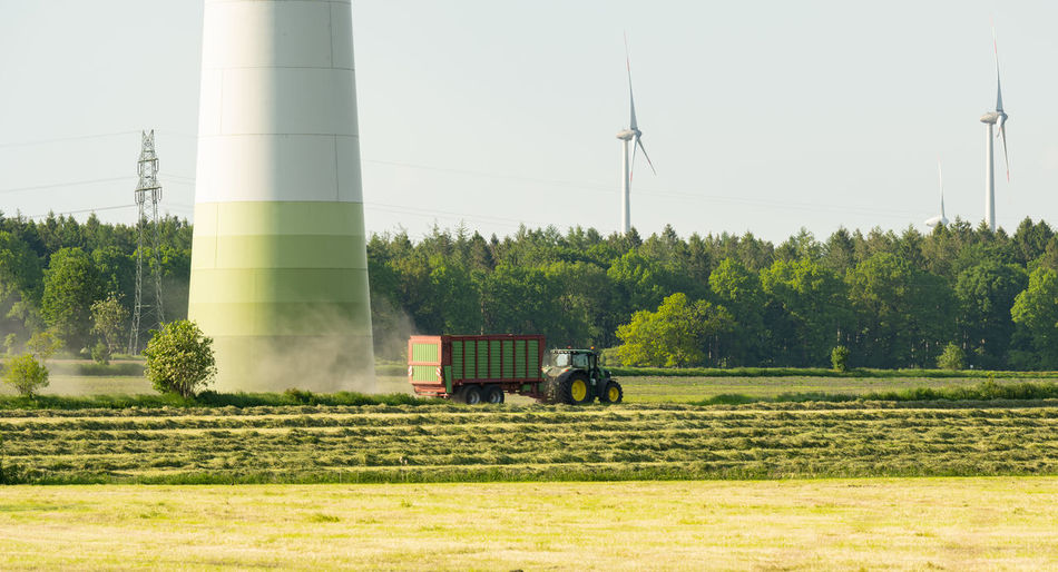 Agricultural vehicle on field against sky