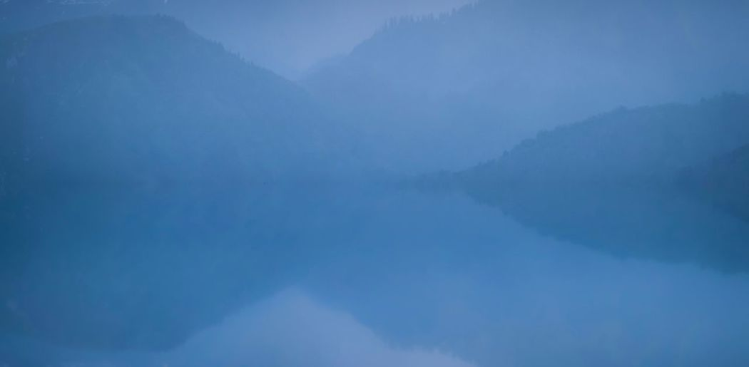 Scenics - Nature Beauty In Nature Tranquil Scene Tranquility Cloud - Sky No People Sky Nature Day Fog Idyllic Non-urban Scene Low Angle View Outdoors Backgrounds Blue Mountain Environment Water Climate