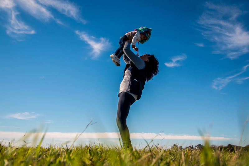 Sky Nature Land Cloud - Sky Field Real People Day Low Angle View One Person Full Length Lifestyles Blue Plant Leisure Activity Grass Young Adult Outdoors Beauty In Nature Men
