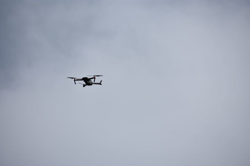 Low Angle View Of Drone Flying In Sky
