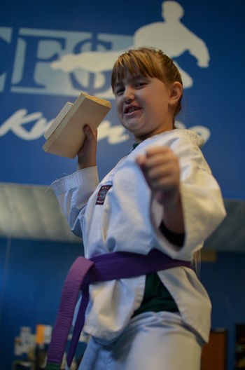 Girl  Posing In Martial Arts Uniform
