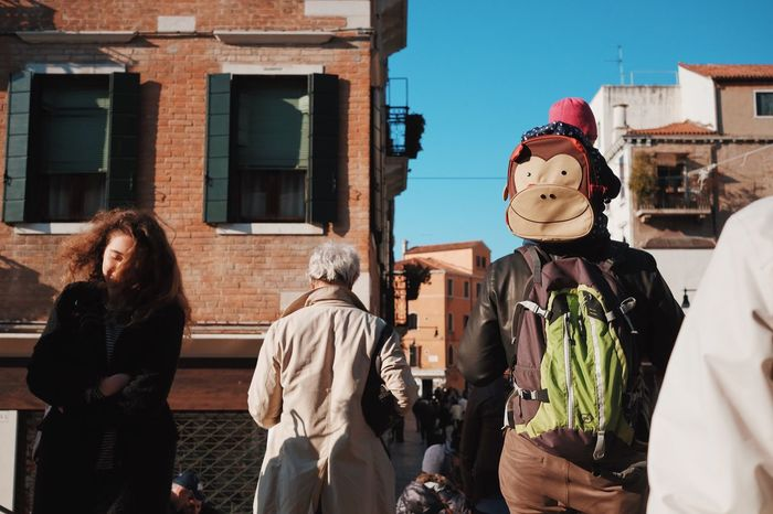 Postcards from Venice: Chimps. Real People Built Structure Building Exterior Architecture Lifestyles Outdoors Day Sky People Adult The Street Photographer - 2017 EyeEm Awards BYOPaper! BYOPaper! Mix Yourself A Good Time