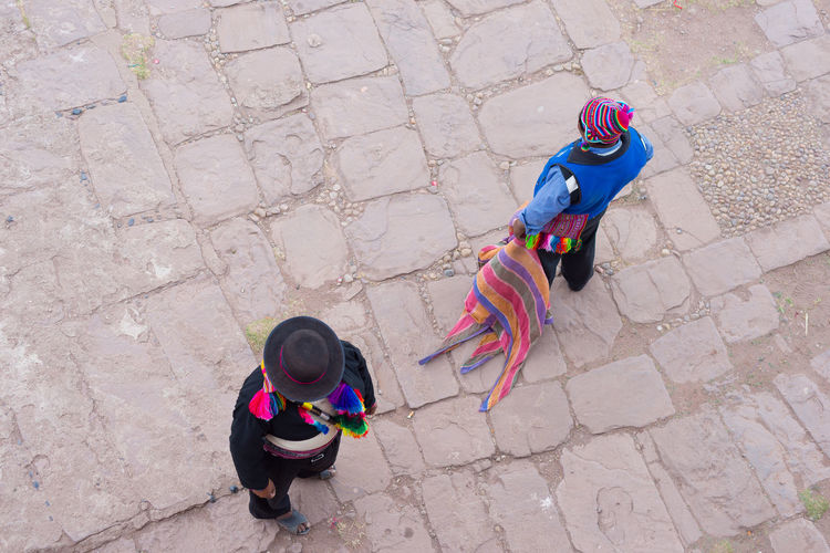 High angle view of men in traditional clothing standing on footpath